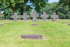 Black crosses and tomb stones on German world war 2 cemetery to Royalty Free Stock Photography