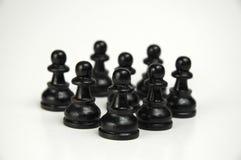 Black Crowd I. Group of black pawns, isolated Stock Image
