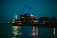 Black Cruiser Ship On Sea Dock Royalty Free Stock Photography
