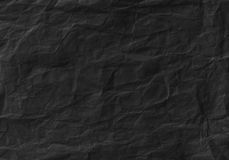 Black crumpled paper texture. Background and wallpaper Stock Image