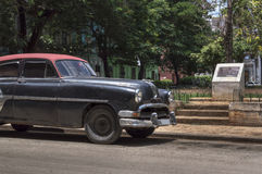 Black cuban car. A classic black car with a red roof, near a park in Old Havana, Cuba royalty free stock photography