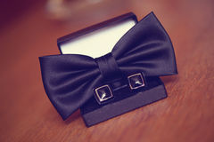 Black cuff links and bowtie Stock Photo
