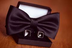 Black cuff links and bowtie Stock Image