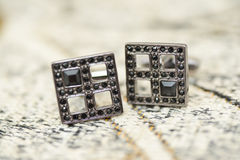 Black cufflinks details Stock Images