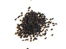 Black Cumin (Nigella Sativa) seeds over white Royalty Free Stock Photos