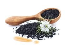 Black cumin oil with flower. On white background Royalty Free Stock Image