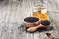 Free Black Cumin Oil With Seeds Stock Images - 111155114
