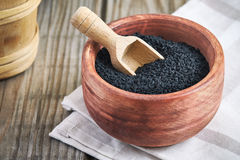 Black cumin seed. Nigella sativa in wooden bowl Stock Images