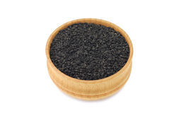 Black cumin seeds in a wooden bowl Stock Images