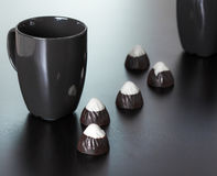 Black Cup with Chocolate Candies Royalty Free Stock Photos