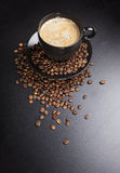 Black cup of coffee with beans. top view Royalty Free Stock Images