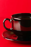 Black cup of coffee close-up Stock Images