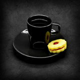 Black cup of coffee on a gray cracked background Stock Images