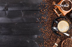 Black cup of coffee, ground coffee, mill, bowl Stock Photography
