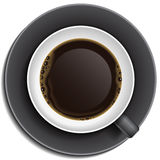 Black cup of coffee on saucer. Top view Royalty Free Stock Images