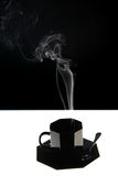 Black cup with fume. Black cup with bright fume Royalty Free Stock Photos