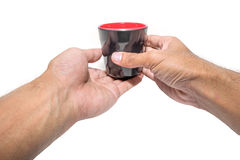 Black cup in his hands. Isolated Royalty Free Stock Photo