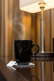Black cup of hot tea Stock Photo
