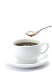Black Cup Of Coffee With Floating Spoon Royalty Free Stock Photos