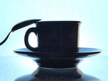 Black Cup, Saucer snd Spoon royalty free stock photos