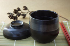 Black cup of tea Stock Photography
