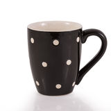 Black cup with white dot Stock Photos