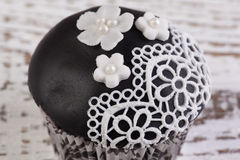 Black cupcake Stock Photography