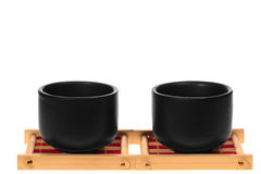 Black cups on a stand Royalty Free Stock Photo