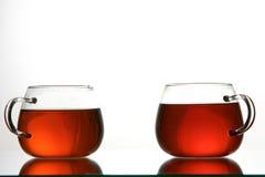 black cups tea Royaltyfria Bilder