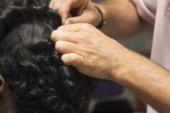 Black curly hair girl at hairdresser Stock Photography