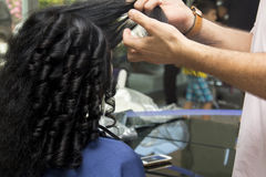 Black curly hair girl at hairdresser Royalty Free Stock Photo
