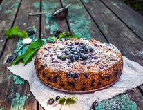 Black currant cake on a beige linen fabric over the old painted Royalty Free Stock Photography