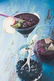 Black currant dessert, smoothie in a glass and frozen black curr Royalty Free Stock Photo
