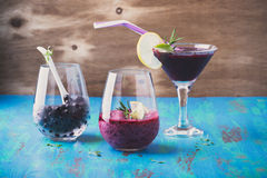 Black currant dessert, smoothie in a glass and frozen black curr Stock Photo