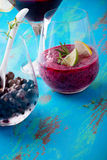 Black currant dessert, smoothie in a glass and frozen black curr Stock Photography