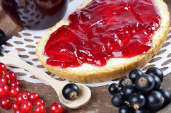 Black currant jam on a slice and Royalty Free Stock Photography