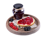 Black currant jam on a slice and Stock Image