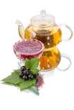Black currant jam and tea Stock Photos