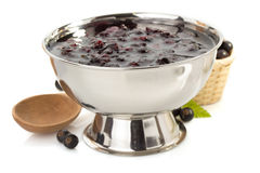 Black currant jam on white Royalty Free Stock Photography