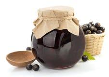 Black currant jam on white Royalty Free Stock Photos