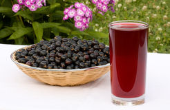 Black currant and juice. Black currant and a glass of juice Royalty Free Stock Photography