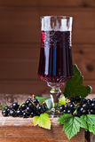 Black currant liquor and ripe berries Royalty Free Stock Photo