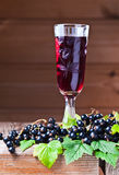 Black currant liquor and ripe berries Stock Images