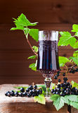 Black currant liquor and ripe berries Royalty Free Stock Photography