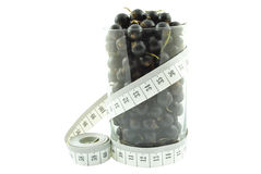 Black currant and meter Royalty Free Stock Images