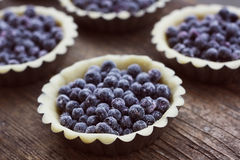 Black currant mini pies Royalty Free Stock Photos