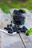 Black currant. On the old table Royalty Free Stock Photography