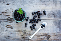 Black currant. On the table Royalty Free Stock Photo