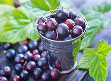 Black currant. On the wooden table Royalty Free Stock Image