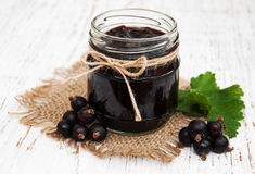Black currants jam and fresh berries Royalty Free Stock Images